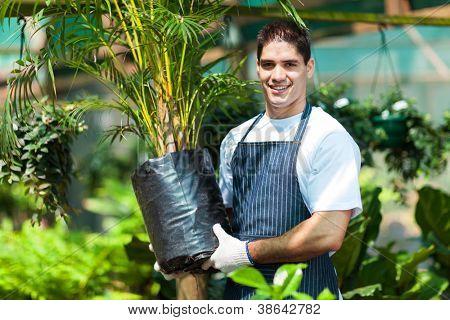 young gardener working in nursery