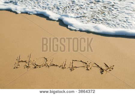 Holiday Written On Sand