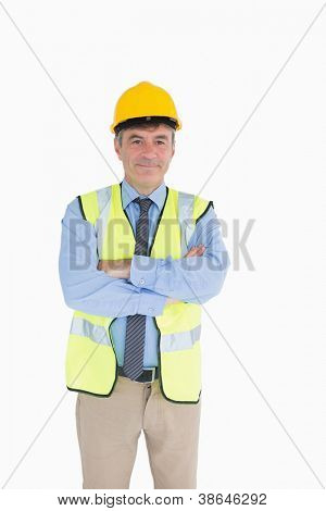 Architect wearing hardhat and high visibility vest with arms crossed