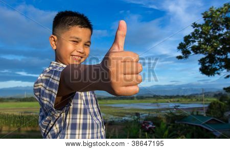 Kid with thumbs up hand gesture