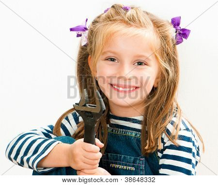 little smiling girl with a wrench