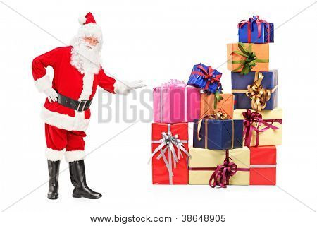 Full length portrait of a Santa Claus offering presents isolated on white background