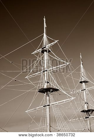ship masts in ice, sepia
