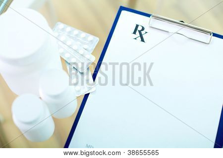Image of medical document, vitamins and tablets