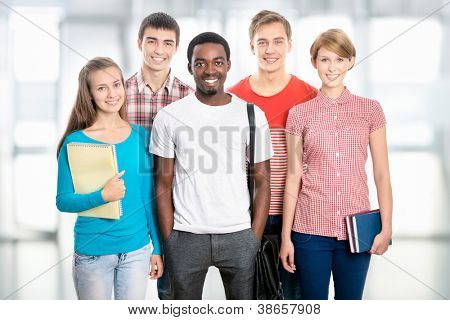 Group of happy young students in a university