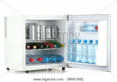 mini fridge full of bottles and jars with various drinks isolated on white