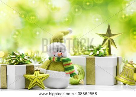 Snowman and gift boxes on abstract background