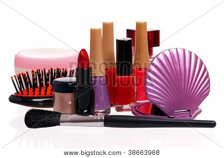 Set of cosmetics - nail polish, small mirror, comb and lipstick on white background