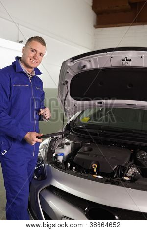 Mechanic holding a tablet computer in a garage