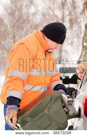 Man filling woman car gas snow assistance winter breakdown help