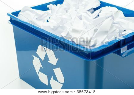 Blue recycling bin box with paper waste on white