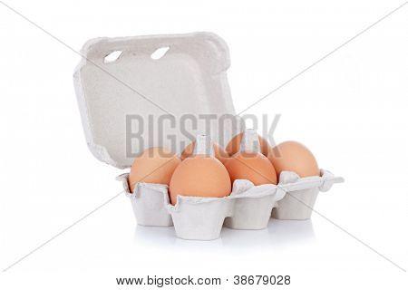 Half dozen  brown chicken eggs in box  isolated on white background