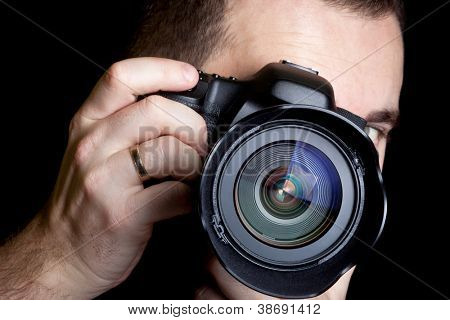 Photographer taking pictures with digital camera