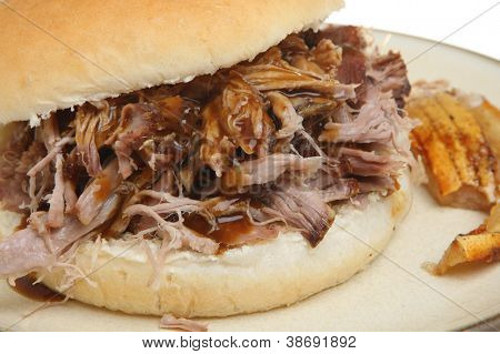 Pulled pork or hog roast sandwich with crackling.