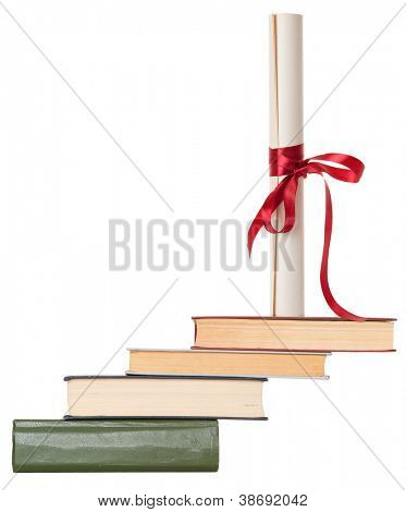 Diploma with red ribbon and books