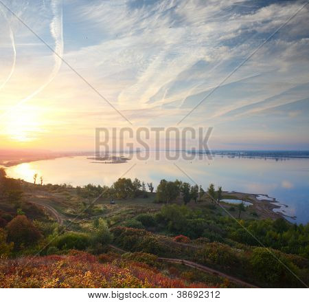 Autumn calm river Kama at sunrise. Russia