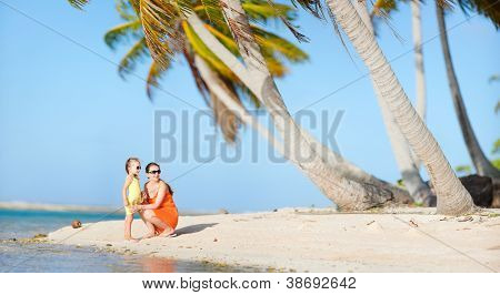 Mother and daughter on a beach at exotic island