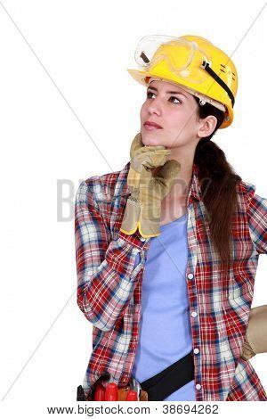 A pensive tradeswoman