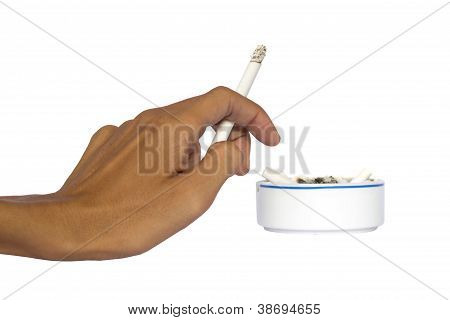 Hand And Ashtray With Cigarettes