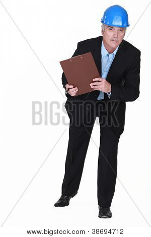 mature foreman holding clipboard