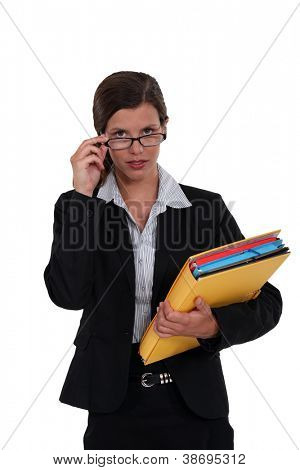 Serious woman holding file folders