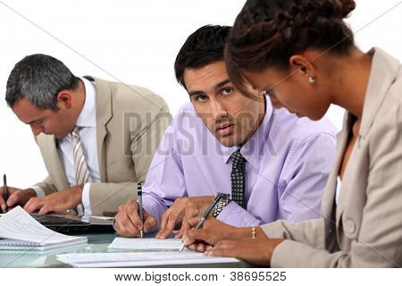 Businesspeople writing notes