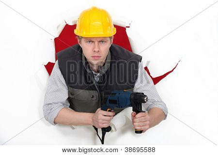Worker wielding drill