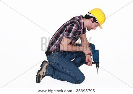 Tradesman using a power tool