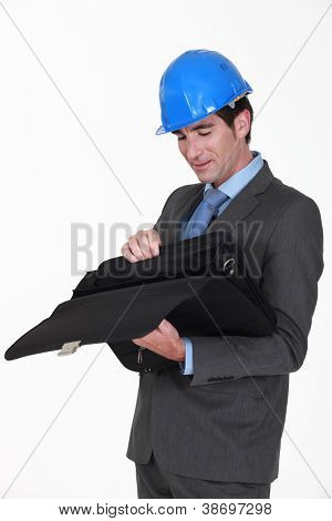 Engineer looking for something in his briefcase