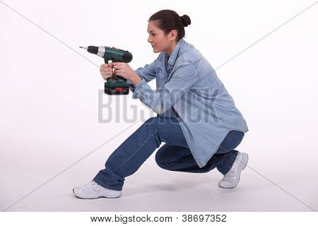Cute brunette using her driller as a gun.