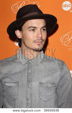 "LOS ANGELES - OCT 16:  Tyler Blackburn arrives at  ""Pretty Little Liars"" Special Halloween Episode Screening at Hollywood Forever Cemetery on October 16, 2012 in Los Angeles, CA"