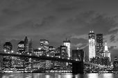 stock photo of bridge  - Brooklyn Bridge and Manhattan Skyline At Night - JPG