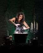 foto of dungeon  - Young sexy witch making the witchcraft in the dungeon - JPG