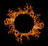 circle of orange flame isolated on black background