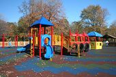 stock photo of day care center  - community playground in park with colorful gymset and swings - JPG