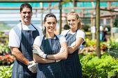 stock photo of greenhouse  - group of florists portrait in greenhouse - JPG