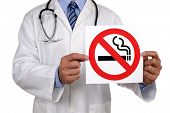 Doctor advice holding a no smoking sign