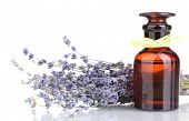 stock photo of fragrance  - Lavender flowers and glass bottle isolated on white - JPG