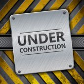 stock photo of reconstruction  - Under construction metal sign on metallic warning stripes - JPG
