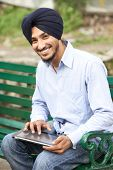 stock photo of rajasthani  - Portrait of Indian sikh man in turban with bushy beard - JPG