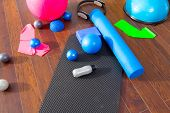 stock photo of rubber band  - Aerobic Pilates stuff like mat balls roller magic ring rubber bands on wooden floor - JPG