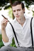 Man Thinks While Smoking Cigar