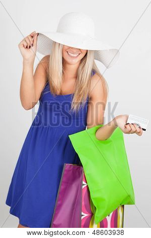 Portrait Of A Young Woman Smiling With Her Shopping Bags