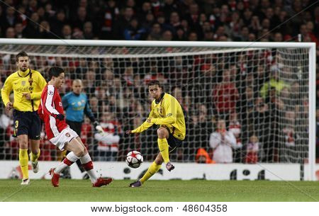 LONDON, ENGLAND. 31/03/2010. Barcelona's Pedro Rodraguez clears the ball as Arsenal's Samir Nasri rushes in, during the  UEFA Champions League quarter-final at the Emirates Stadium