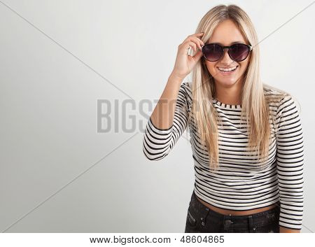 Portrait Of A Young Woman With Sunglasses