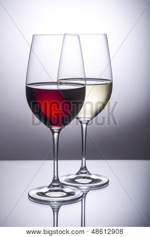 Glass of Red and White Wine Back Lit