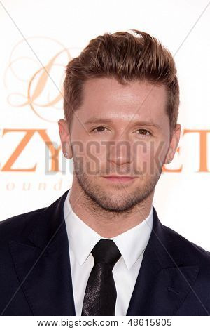 Jesse SpencerLOS ANGELES - JUL 27:  Travis Wall arrives at the 3rd Annual Celebration of Dance Gala at the Dorothy Chandler Pavilion on July 27, 2013 in Los Angeles, CA