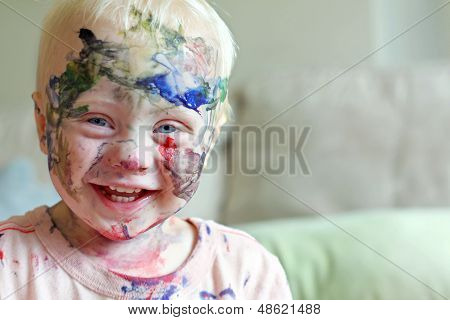 Laughing Baby Covered In Paint
