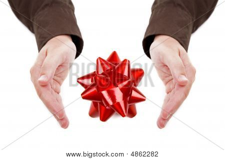 Man Hands Holding Red Bow Isolated On White Background