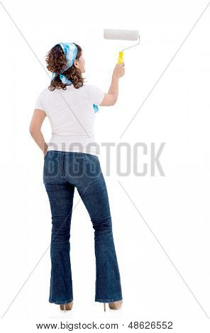 Woman painting a white wall and redecorating her house - isolated